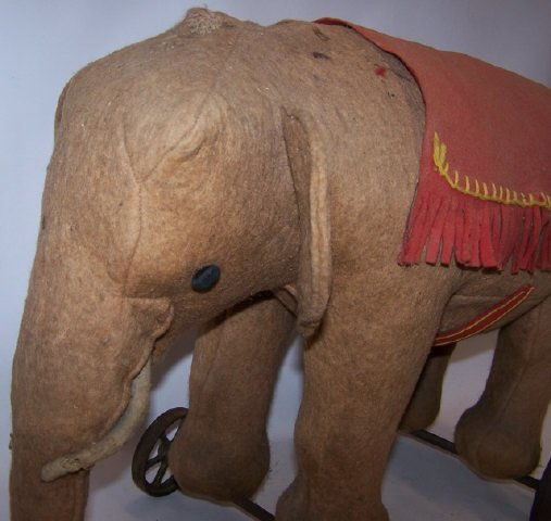 *EARLY STUFFED ELEPHANT ON WHEELS - 6