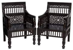 BRITISH COLONIAL STYLE CARVED MAHOGANY ARMCHAIRS