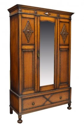 ENGLISH JACOBEAN STYLE CARVED OAK ARMOIRE, 1930S