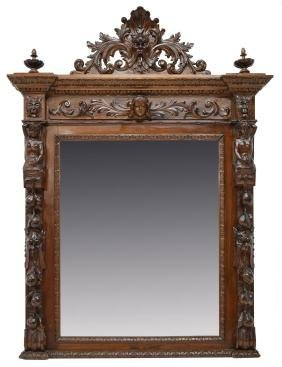 Italian Highly Carved Figural Beveled Wall Mirror
