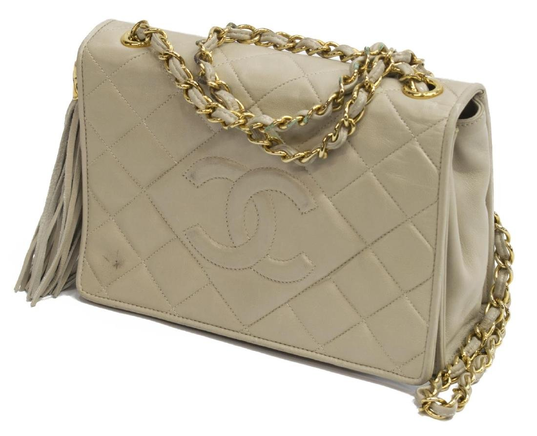 CHANEL QUILTED IVORY LEATHER TASEL FLAP BAG