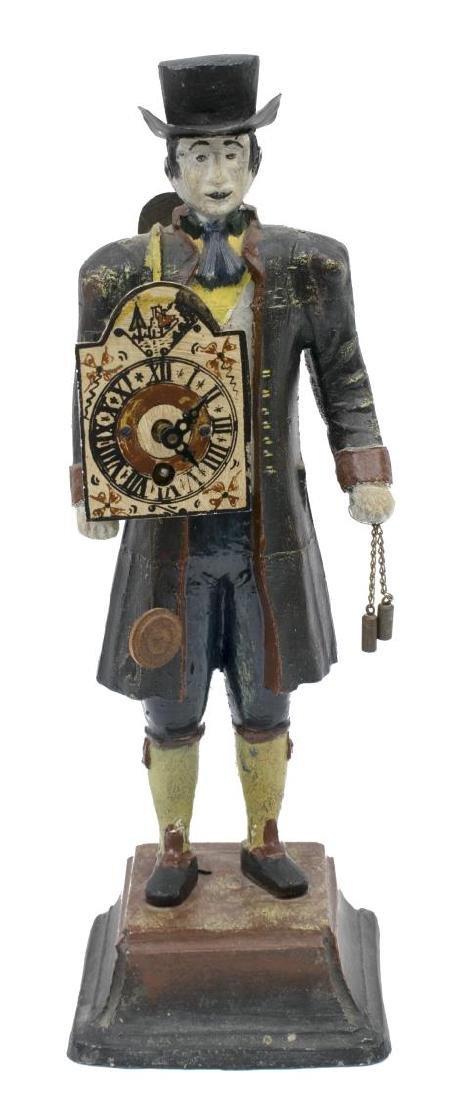 ANTIQUE POLYCHROME METAL TRAVELING CLOCK PEDDLER