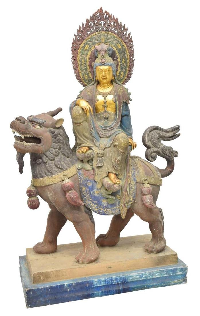MONUMENTAL CARVED PARCEL GILT KWAN-YIN STATUE
