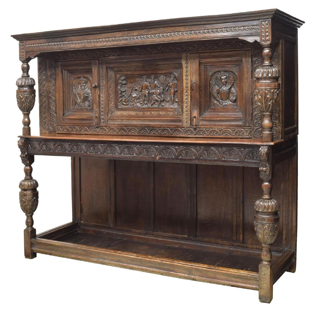 ENGLISH HEAVILY CARVED OAK COURT SIDEBOARD
