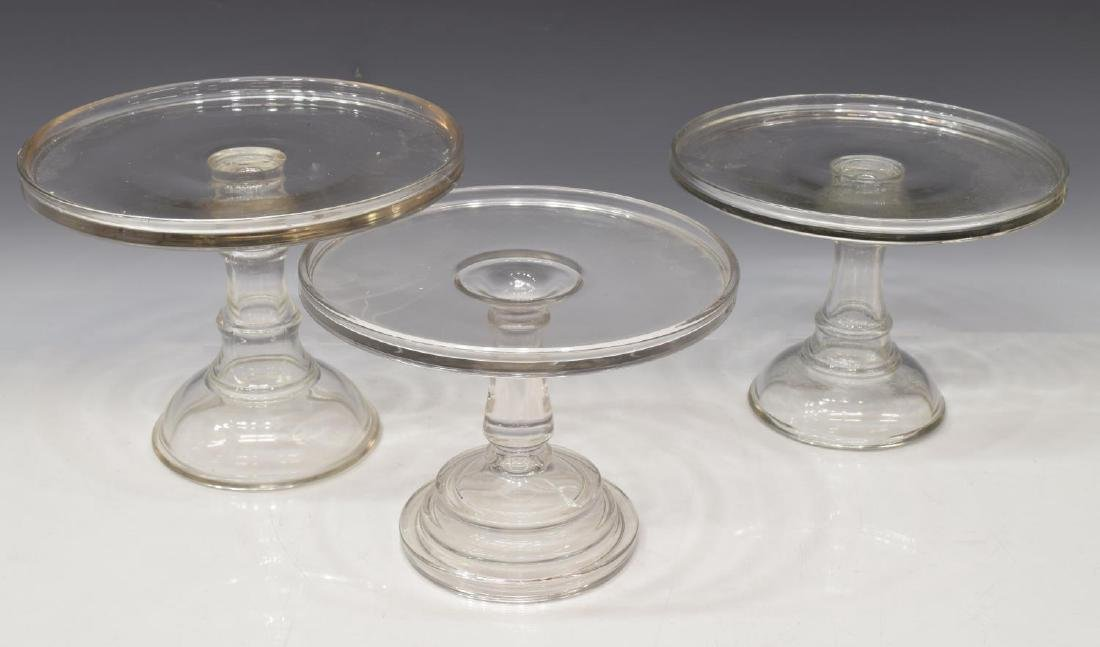 (3) COLORLESS MOLDED GLASS CAKE STANDS