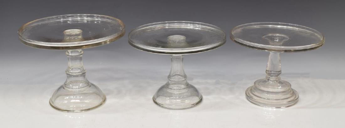 (3) COLORLESS MOLDED GLASS CAKE STANDS - 2
