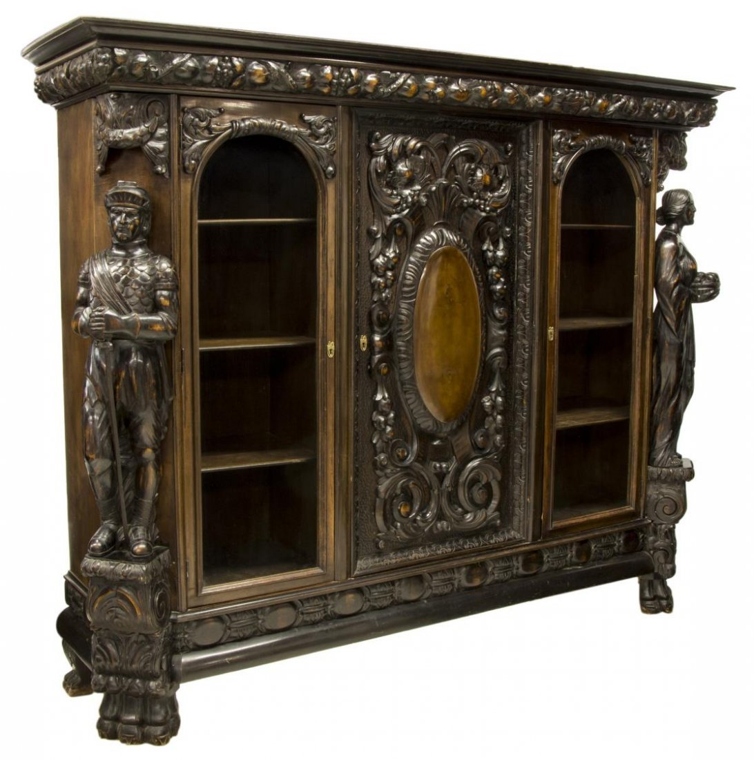 RENAISSANCE REVIVAL HEAVILY CARVED FIGURAL CABINET