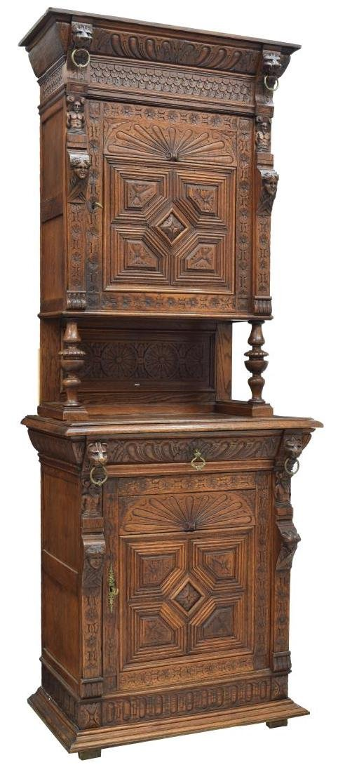 FRENCH HEAVILY CARVED OAK CABINET, LION MASKS