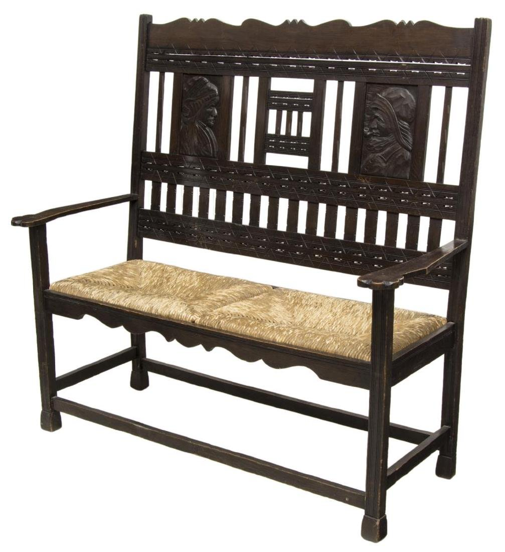 FRENCH FIGURAL CARVED HIGHBACK BENCH, RUSH CANE