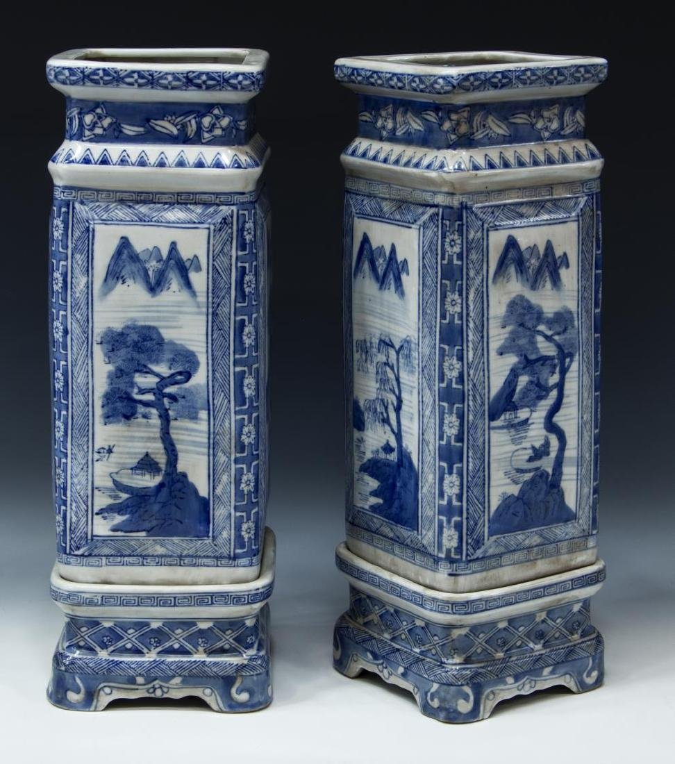 (2) CHINESE BLUE AND WHITE SQUARE VASES ON STANDS