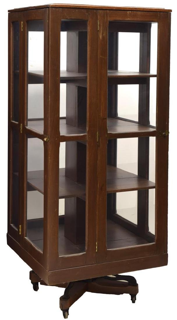 REVOLVING BOOKCASE WITH GLASS DOORS