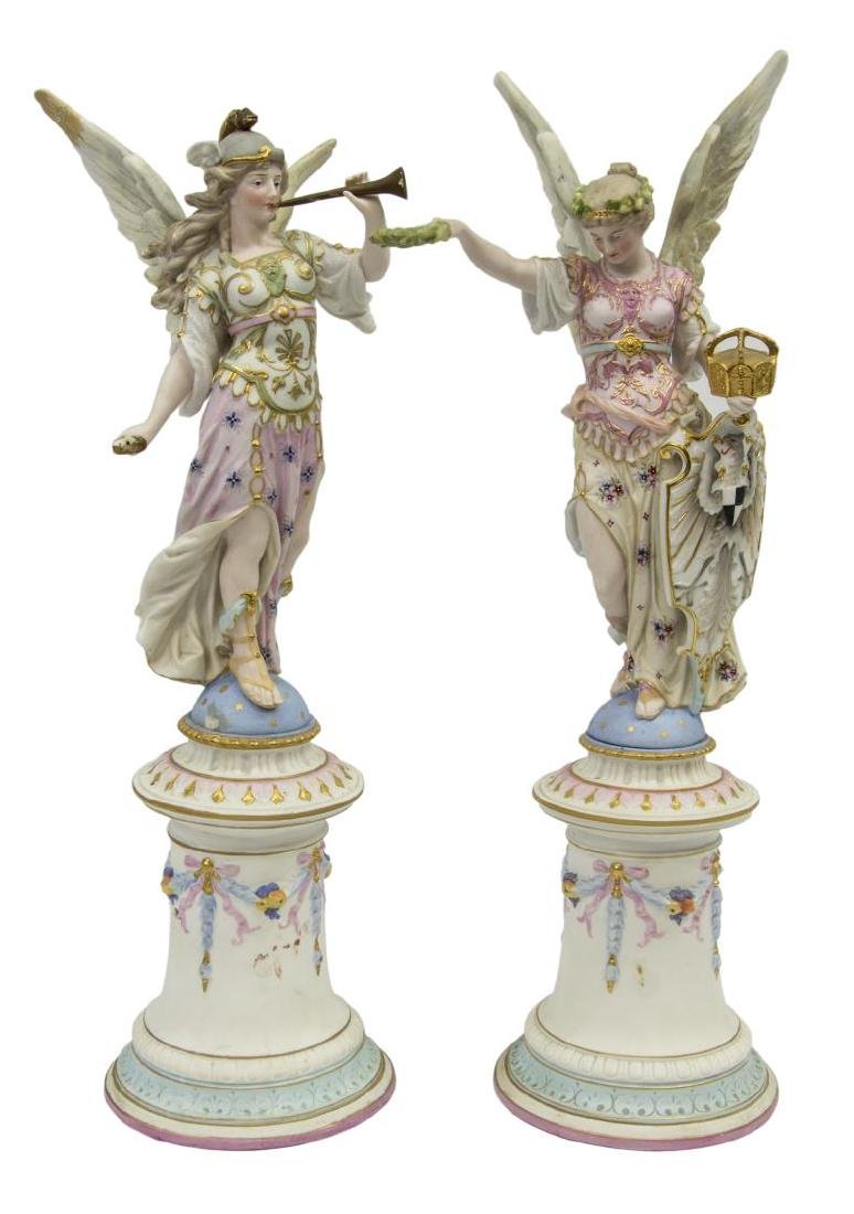 (2) LARGE COLORED BISQUE WINGED ANGEL FIGURES