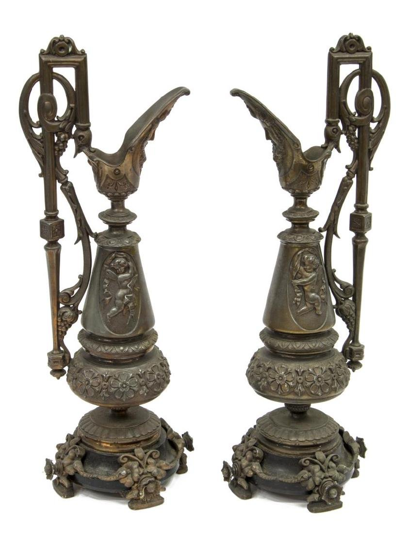 (2) ANTIQUE HEAVY MIXED METAL PUTTI & FLORAL EWERS