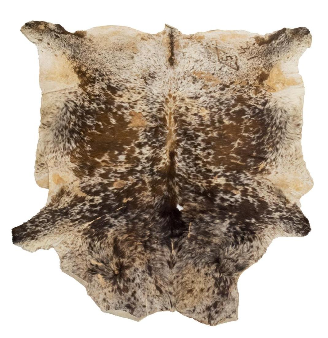 TANNED BROWN AND WHITE SPOTTED COW HIDE