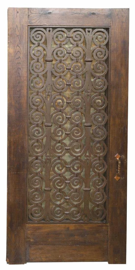 ARCHITECTURAL DOOR WITH SCROLLED IRON PANEL