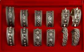 12 COLLECTION OF STERLING SILVER NAPKIN RINGS