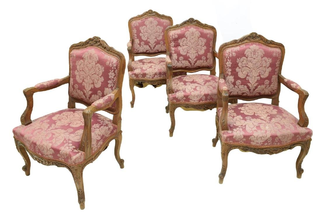 (4) LOUIS XV STYLE FLORAL CARVED WALNUT ARM CHAIRS