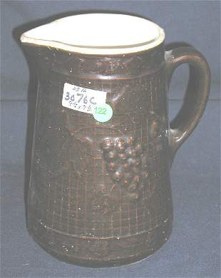STONEWARE PITCHER GRAPES OVER BASKET BACKGROUND, W