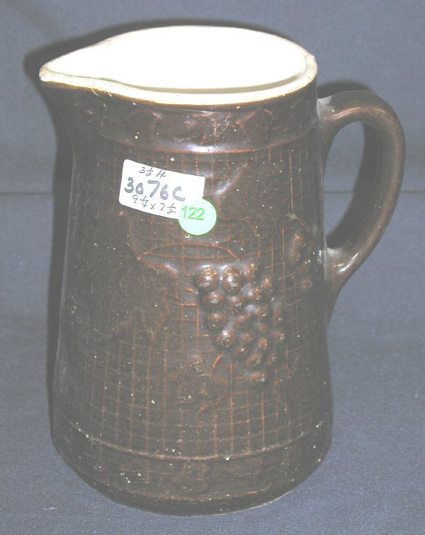 122: STONEWARE PITCHER GRAPES OVER BASKET BACKGROUND, W