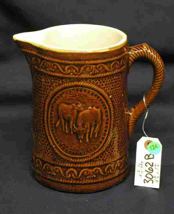 STONEWARE PITCHER COWS BROWN PUNCHED DESIGN WITH