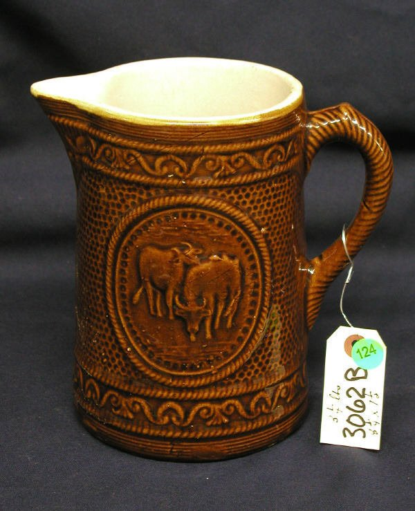 124: STONEWARE PITCHER COWS BROWN PUNCHED DESIGN WITH
