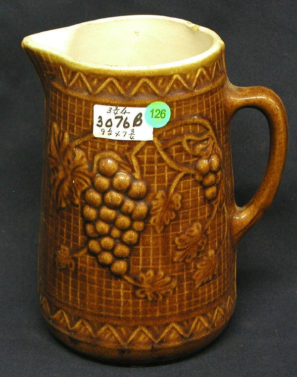 126: STONEWARE PITCHER GRAPES OVER BASKET BACKGROUND, B