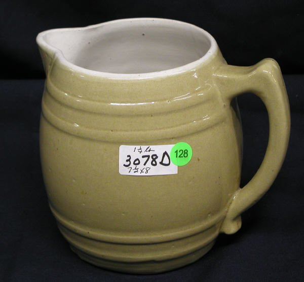 128: STONEWARE PITCHER TAN COLOR HANDLE, TWO RINGS TOP