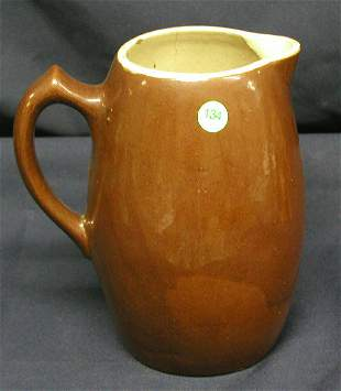 """STONEWARE PITCHER BROWN 9""""H, 7.7""""D, .5LB, CHIPS IN"""