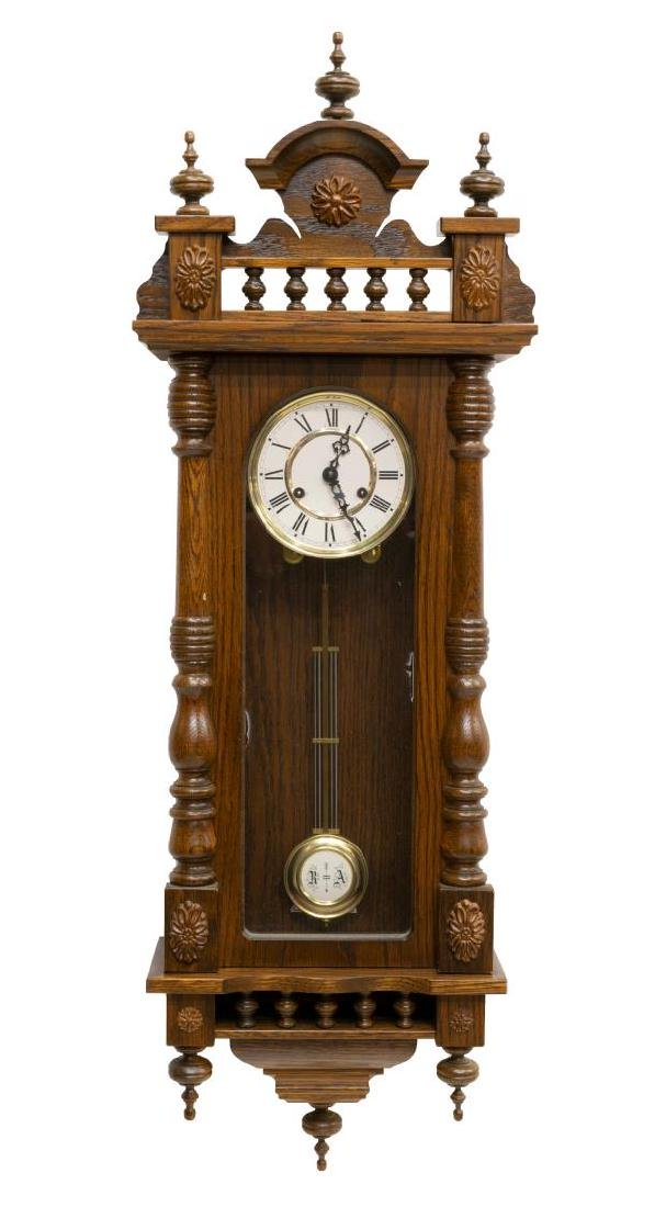 GERMAN TIME & STRIKE SPINDLED OAK WALL CLOCK