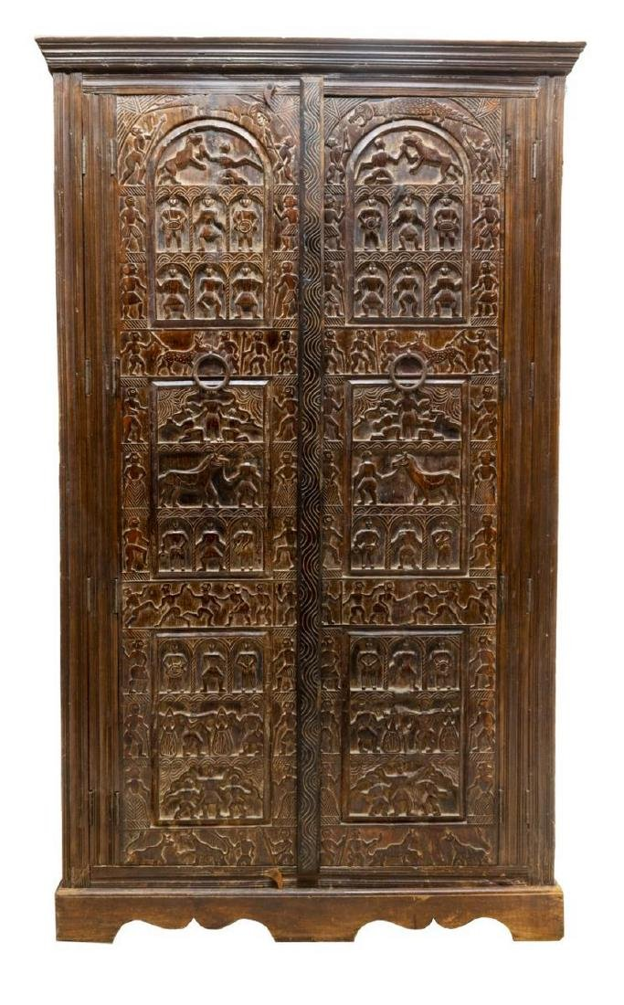 HEAVILY CARVED INDIA ARCHITECTURAL PANEL ARMOIRE
