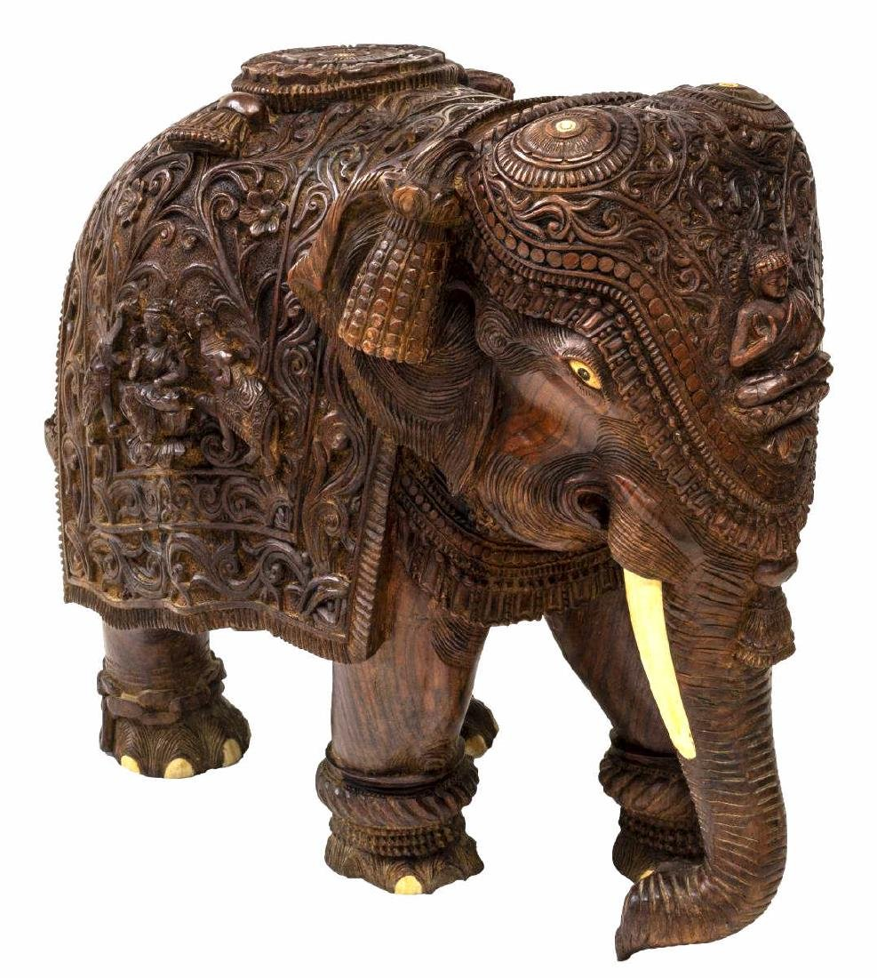 CARVED TEAK FIGURE OF AN ELEPHANT WITH BONE INLAY