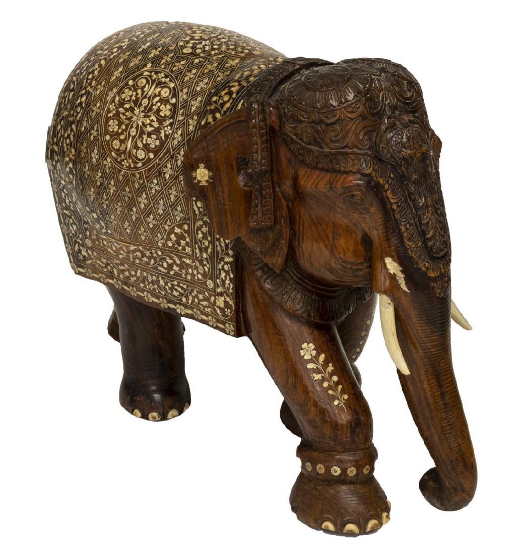 CARVED TEAK FIGURE OF AN ELEPHANT WITH BONE INLAY