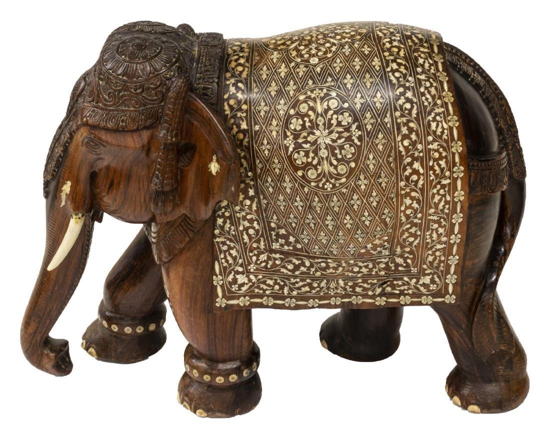 CARVED TEAK FIGURE OF AN ELEPHANT WITH BONE INLAY - 3