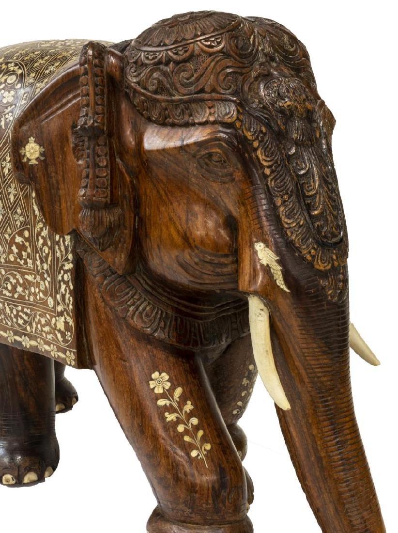 CARVED TEAK FIGURE OF AN ELEPHANT WITH BONE INLAY - 4
