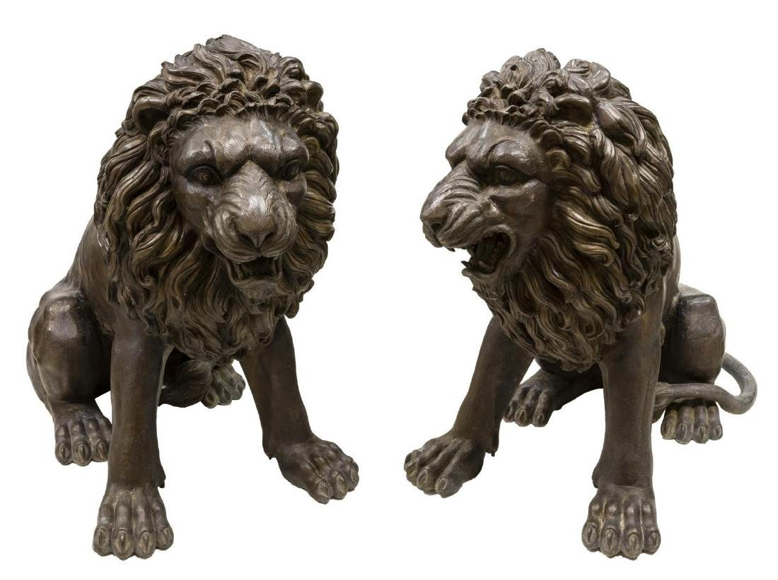 (2) NEAR LIFE-SIZE PATINATED BRONZE SEATED LIONS