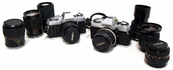 726: TWO VINTAGE MINOLTA SLR CAMERAS, SIX ASSORTED LENS