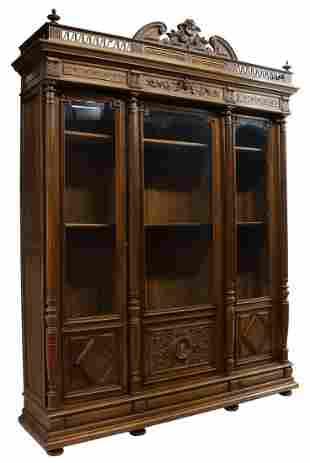 FRENCH HENRI II STYLE CARVED WALNUT BOOKCASE