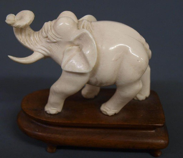 514: SMALL CARVED IVORY FIGURE OF AN ELEPHANT