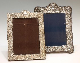 24: (2) STERLING SILVER REPOUSSE PICTURE FRAMES