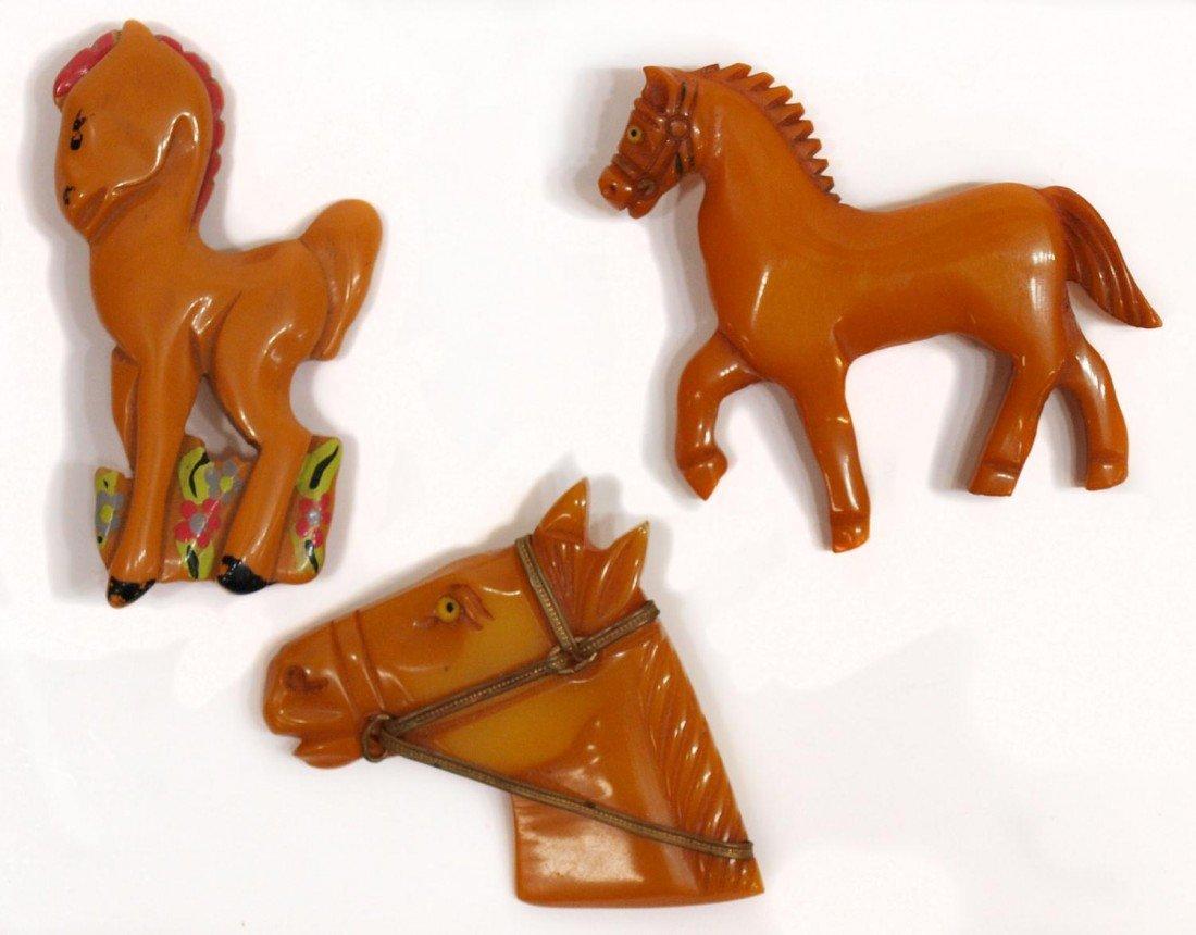 3: (3) LOT VINTAGE BUTTERSCOTCH BAKELITE HORSE PINS