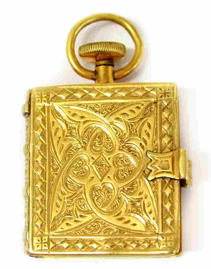 333: ANTIQUE PERRYS PATENT ENGRAVED 10KT BOOK PENDANT