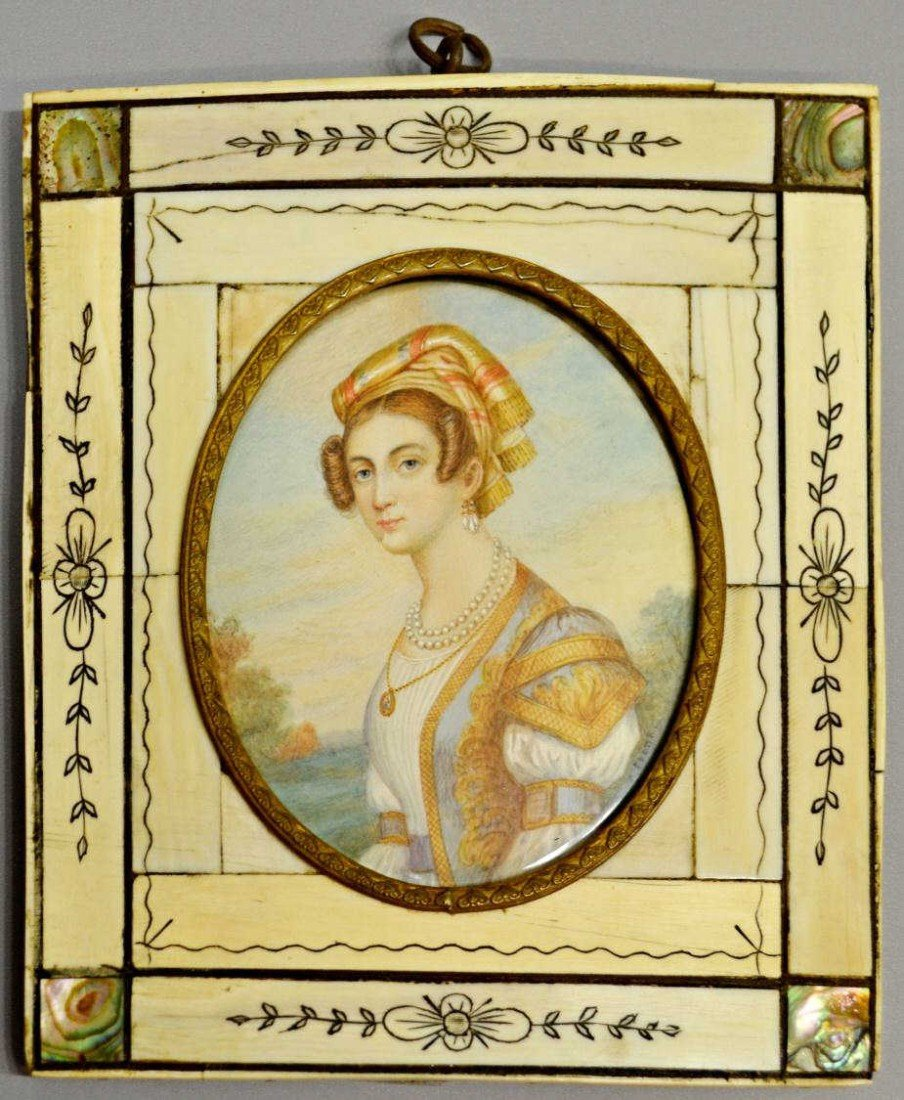 44: IVORY FRAMED MINIATURE PORTRAIT OF A LADY