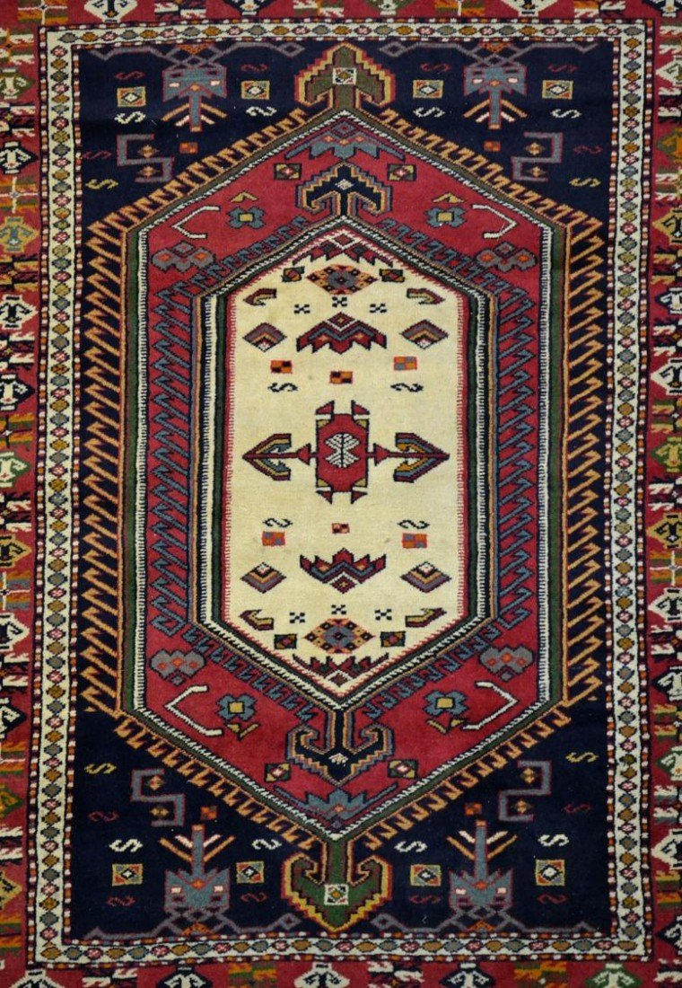 16: SMALL HAND TIED PERSIAN RUG