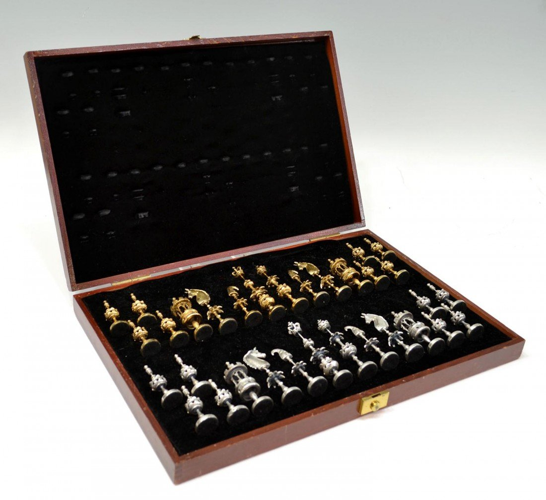 261: POM? GILT & PEWTER FINISH CASED CHESS PIECES SET