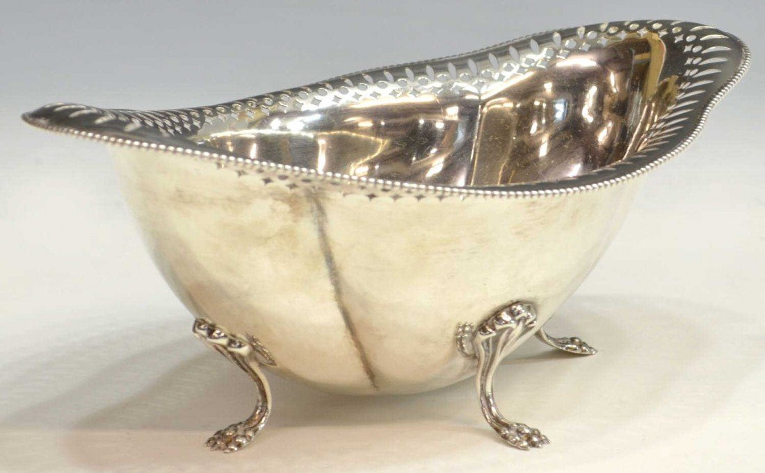 16: A PAW FOOT STERLING SILVER BOWL OF OVAL FORM