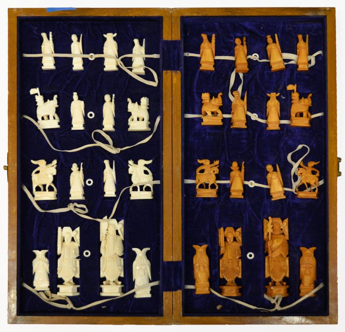 612: CHINESE CARVED IVORY CHESS SET
