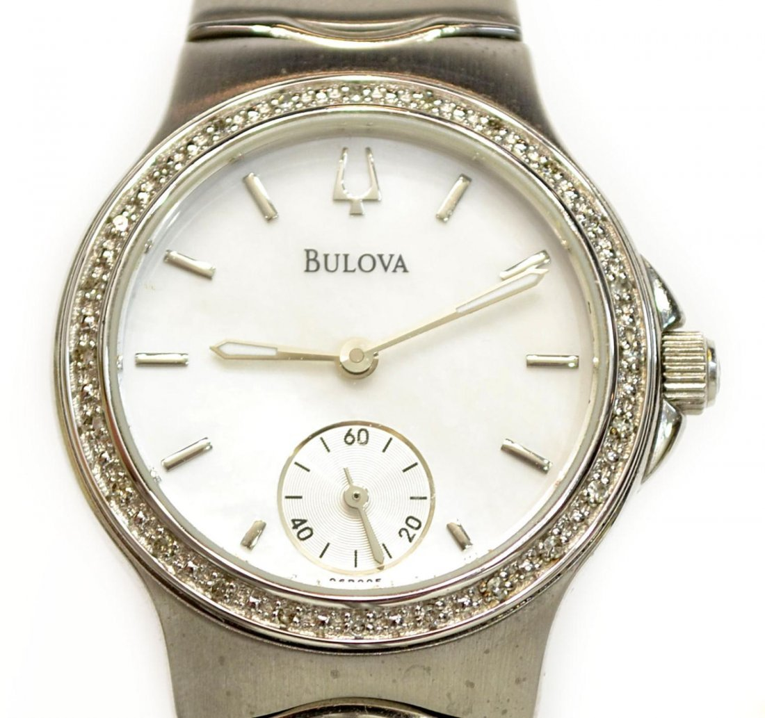 130: LADIES BULOVA STAINLESS DIAMOND BEZEL WRISTWATCH
