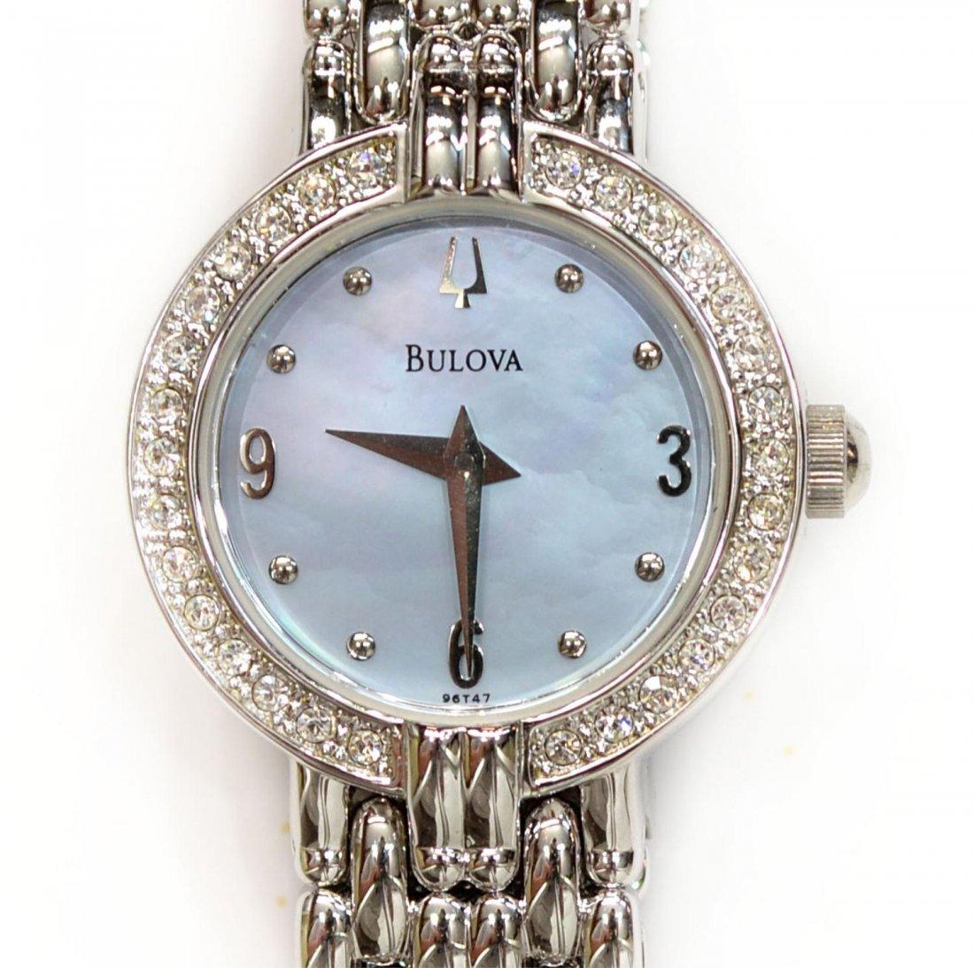 133: LADIES BULOVA STAINLESS & DIAMOND BEZEL WRISTWATCH