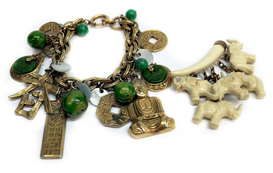 87: VINTAGE BAKELITE CHARM BRACELET, ELEPHANT PIN