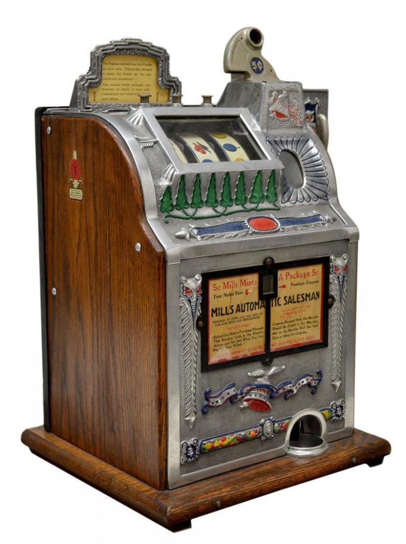 104: VINTAGE MILLS 'AUTOMATIC SALESMAN' SLOT MACHINE